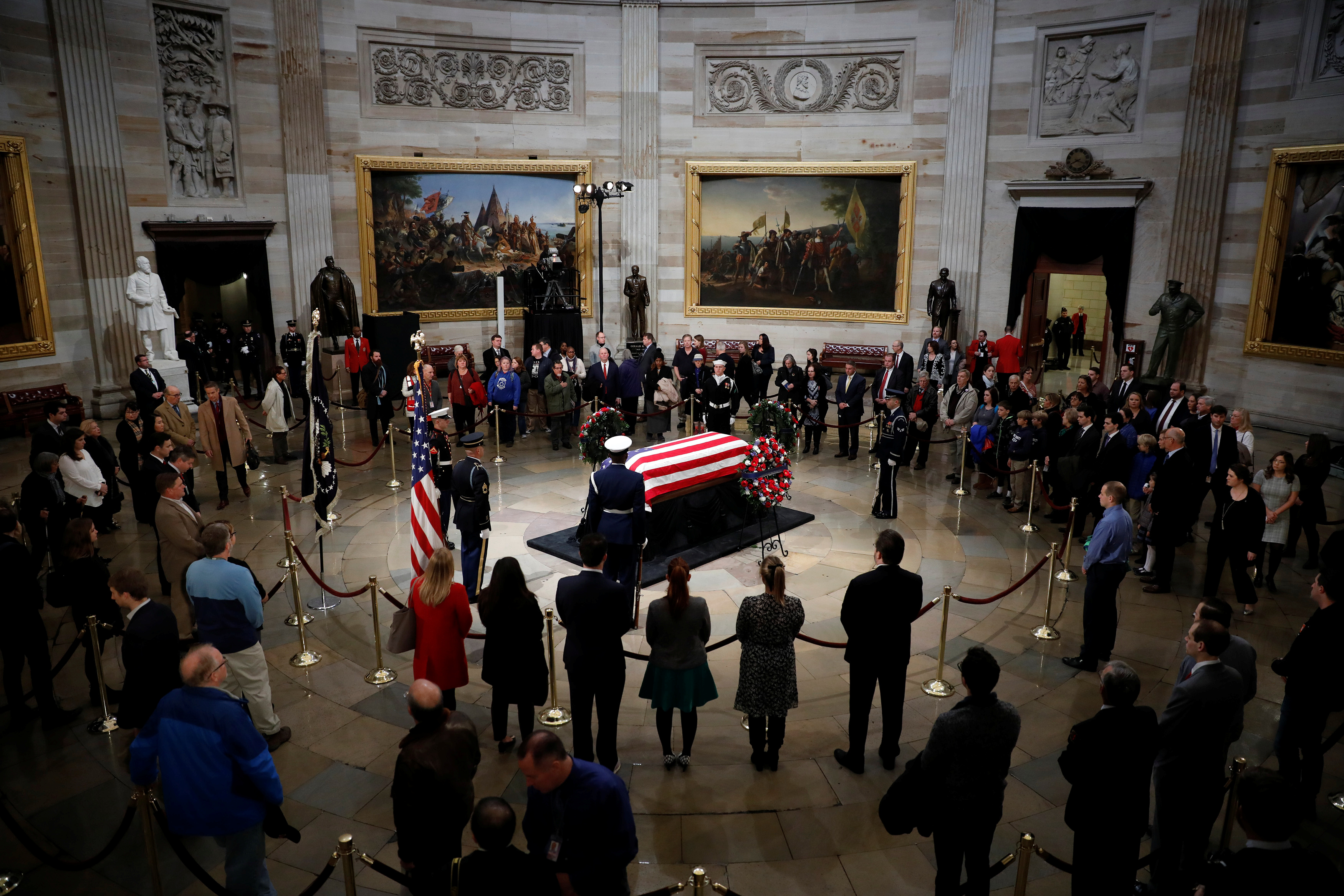 Mourners pay their respects at the casket of former U.S. President George H.W. Bush as it lies in state inside the U.S. Capitol Rotunda on Capitol Hill in Washington, U.S., December 4, 2018. REUTERS/Aaron P. Bernstein