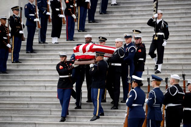 The flag-draped casket of former President George H.W. Bush is carried by a joint services military honor guard from the U.S. Capitol, Wednesday, Dec. 5, 2018, in Washington. Alex Brandon/Pool via REUTERS