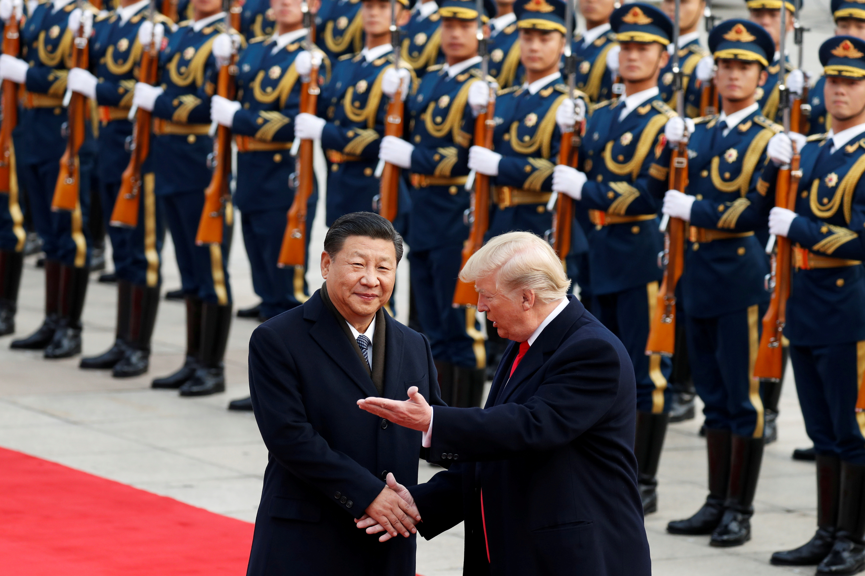 FILE PHOTO: U.S. President Donald Trump takes part in a welcoming ceremony with China's President Xi Jinping in Beijing, China, November 9, 2017. REUTERS/Damir Sagolj