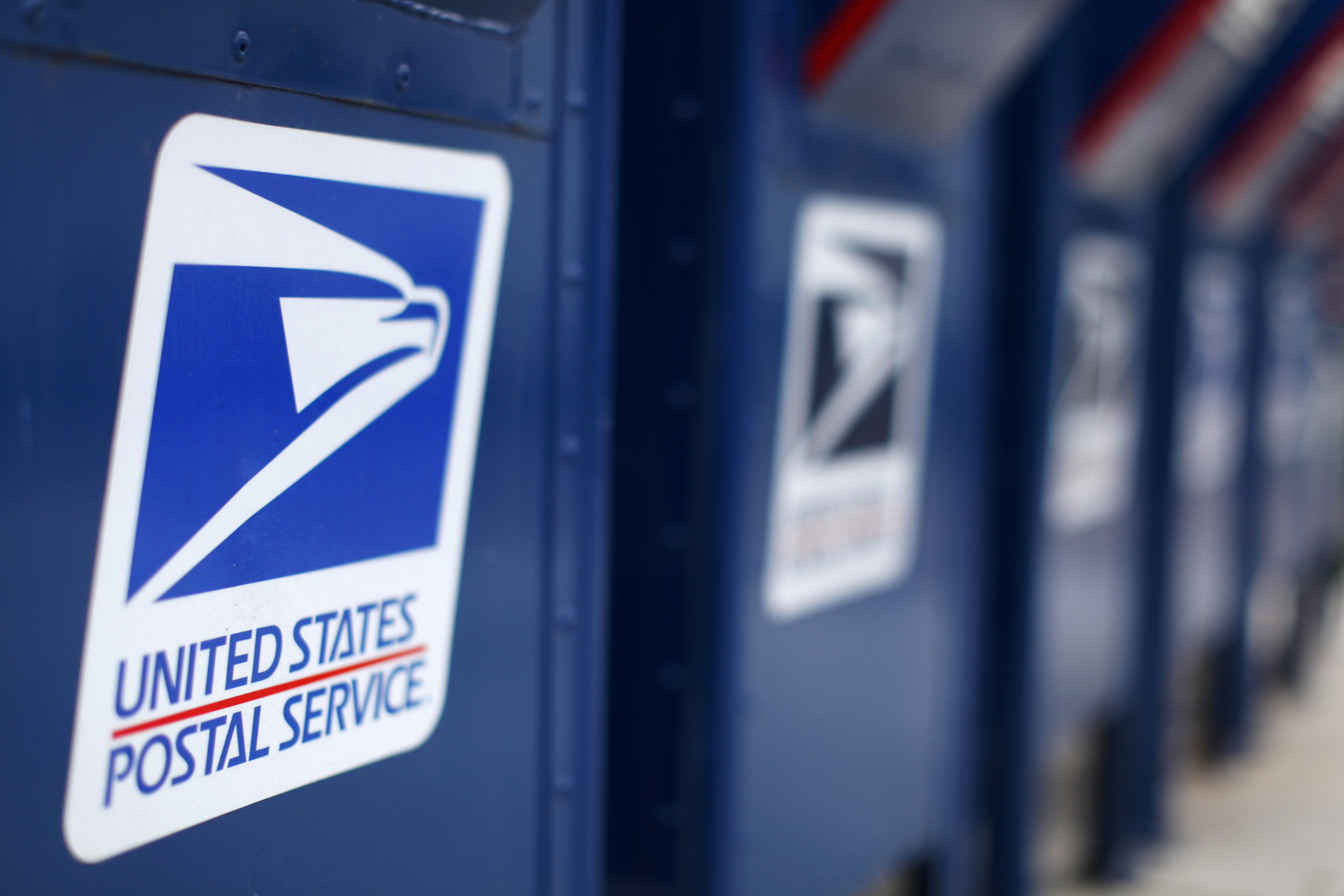 FILE PHOTO - A view shows U.S. postal service mail boxes at a post office in Encinitas, California in this February 6, 2013, file photo. REUTERS/Mike Blake/Files