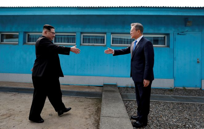 South Korean President Moon Jae-in and North Korean leader Kim Jong Un shake hands at the truce village of Panmunjom inside the demilitarized zone separating the two Koreas, South Korea, April 27, 2018. Korea Summit Press Pool/Pool via Reuters/File Photo