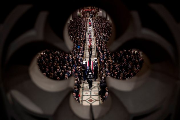 The flag-draped casket of former President George H.W. Bush is arrives carried by a military honor guard during a State Funeral at the National Cathedral, Wednesday, Dec. 5, 2018, in Washington. Andrew Harnik/Pool via REUTERS
