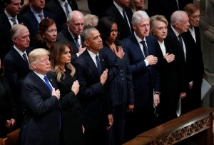 U.S. President Donald Trump and first lady Melania Trump stand with former President Barack Obama, former first lady Michelle Obama, former President Bill Clinton, former first lady Hillary Clinton, former President Jimmy Carter and former first lady Rosalynn Carter in the front row at the state funeral for former U.S. President George H.W. Bush at the Washington National Cathedral in Washington, U.S., December 5, 2018. REUTERS/Kevin Lamarque