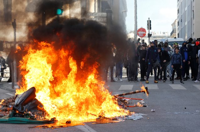 Trash bins burn as youths and high-school students clash with police during a demonstration against the French government's reform plan in Marseille, France, December 6, 2018. REUTERS/Jean-Paul Pelissier