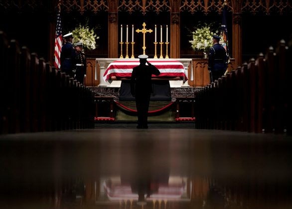 People pay their respects as the flag-draped casket of former President George H.W. Bush lies in repose at St. Martin's Episcopal Church Wednesday, Dec. 5, 2018, in Houston. David J. Phillip/Pool via REUTERS