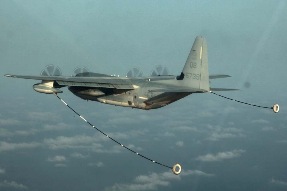 FILE PHOTO: A KC-130 Hercules with Marine Medium Helicopter Squadron 364 (Rein.), 15th Marine Expeditionary Unit, prepares to refuel a CH-53E Super Stallion during air refueling training in the U.S. 5th Fleet area of responsibility, March 14, 2013. Marine Corps photo by Cpl. John Robbart III/Handout via REUTERS