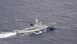 A Japan Coast Guard patrol vessel sails on the water at the area where two U.S. Marine Corps aircraft have been involved in a mishap in the skies, off the coast of Kochi prefecture, Japan, in this aerial view photo taken by Kyodo December 6, 2018. Kyodo/via REUTERS