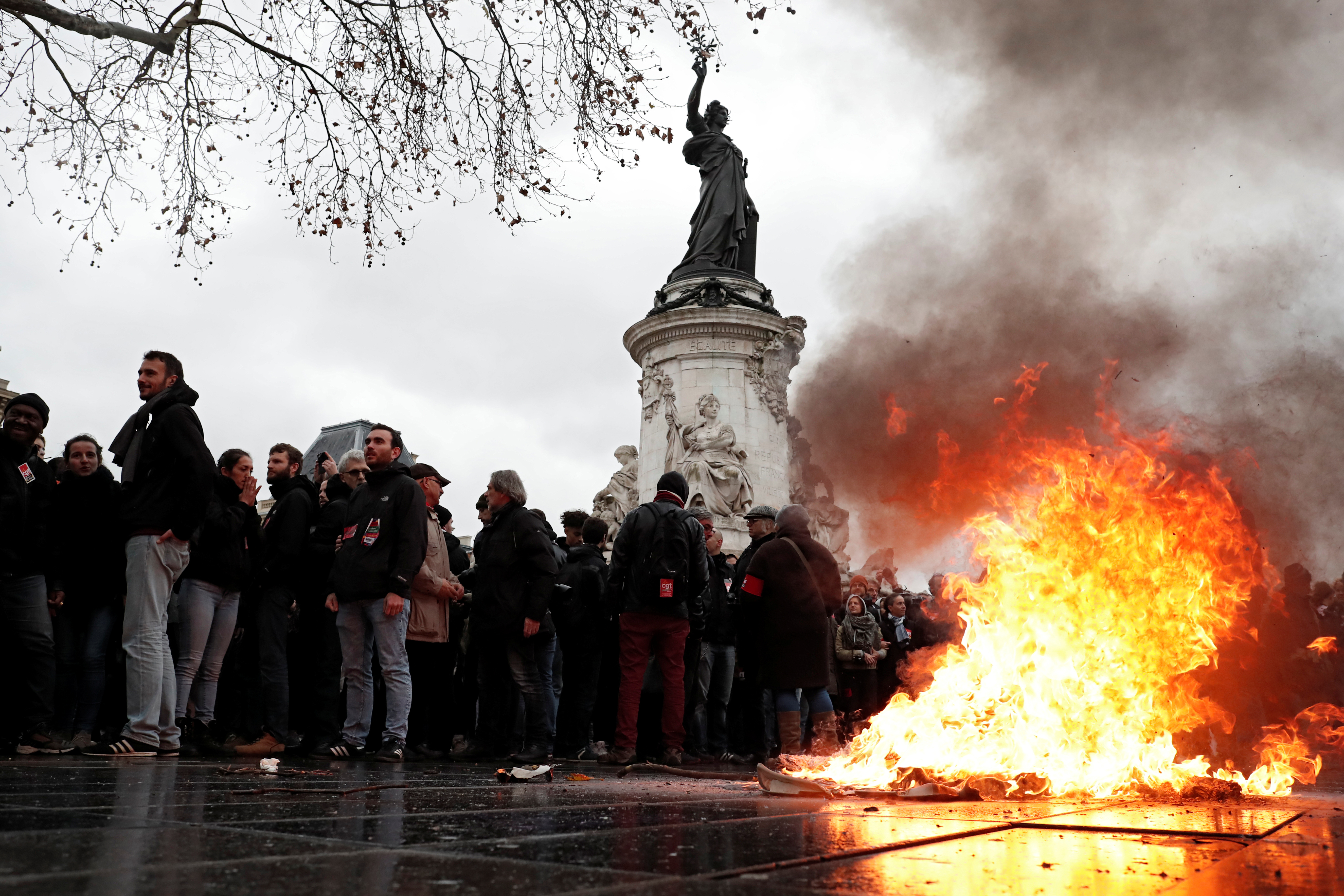 A trash bin burns as youths and high school students attend a demonstration to protest against the French government's reform plan, in Paris, France, December 7, 2018. REUTERS/Benoit Tessier