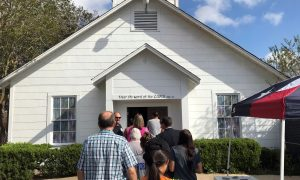 People gather to enter a memorial in the Sutherland Springs First Baptist Church where a memorial has been set up to remember those killed there, in a mass shooting in Sutherland Springs, Texas, U.S. November 15, 2017. REUTERS/Jon Herskovitz