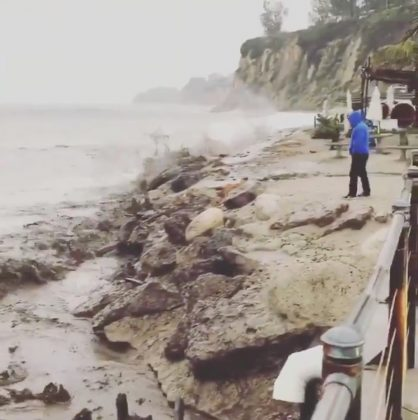 Mud flows along a beach in Malibu, California, U.S., December 6, 2018, in this still image taken from a video obtained from social media. Mike Gardner/via REUTERS