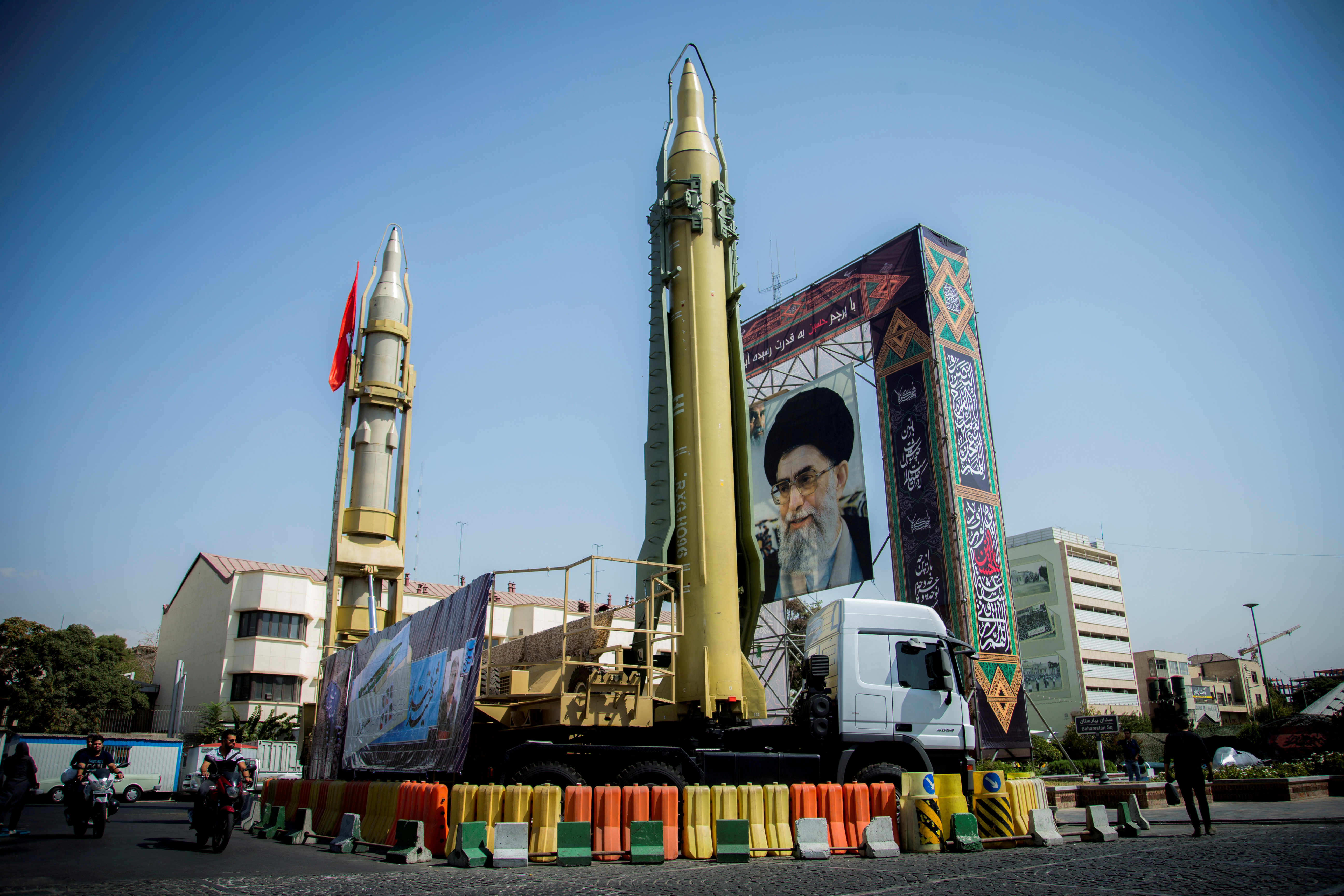 FILE PHOTO: A display featuring missiles and a portrait of Iran's Supreme Leader Ayatollah Ali Khamenei is seen at Baharestan Square in Tehran, Iran September 27, 2017. Picture taken September 27, 2017. Nazanin Tabatabaee Yazdi/TIMA via REUTERS