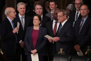 FILE PHOTO: Justices of the U.S. Supreme Court including (L-R) Associate Justices Stephen Breyer, Neil Gorsuch, Elena Kagan, Brett Kavanaugh, Clarence Thomas, Chief Justice John Roberts and Associate Justice Samuel Alito await the arrival of the casket of former U.S. President George H.W. Bush inside the U.S. Capitol Rotunda in Washington, U.S., December 3, 2018. REUTERS/Jonathan Ernst/Pool/File Photo