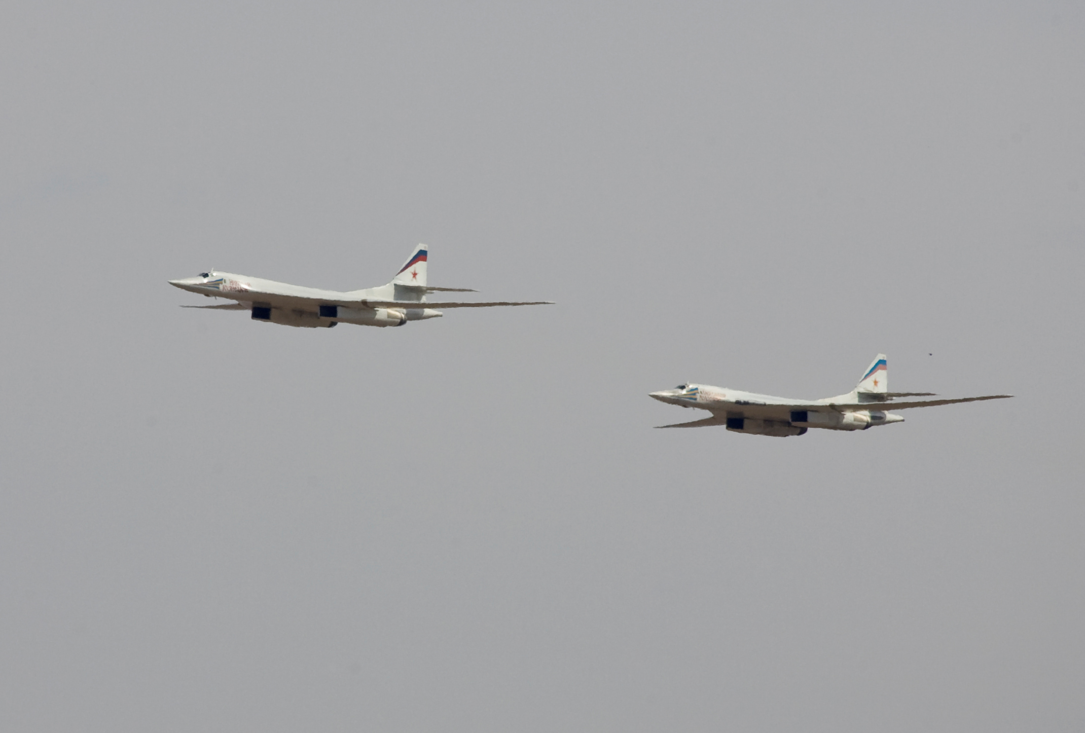 FILE PHOTO: Russian Tu-160 bombers fly during a joint Kazakh-Russian military exercise at Otar military range, some 150km (93 miles) west of Almaty, Kazakhstan, October 3, 2008. REUTERS/Shamil Zhumatov/File Photo