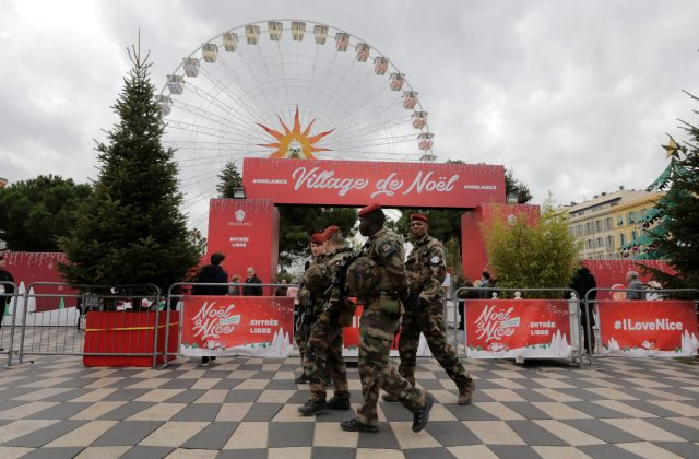 French soldiers patrol past the traditional Christmas market in Nice, France, December 12, 2018. REUTERS/Eric Gaillard
