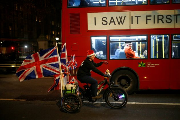 A cyclist displaying Unioin Flags passes the Houses of Parliament, in Westminster, central London, Britain December 11, 2018. REUTERS/Henry Nicholls