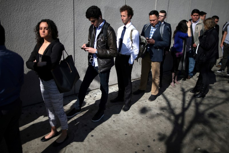 FILE PHOTO: People wait in line to attend TechFair LA, a technology job fair, in Los Angeles, California, U.S., January 26, 2017. REUTERS/Lucy Nicholson