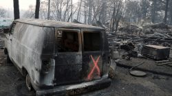FILE PHOTO: A van marked by search crews is seen in the aftermath of the Camp Fire in Paradise, California, U.S., November 17, 2018. REUTERS/Terray Sylvester/File Photo