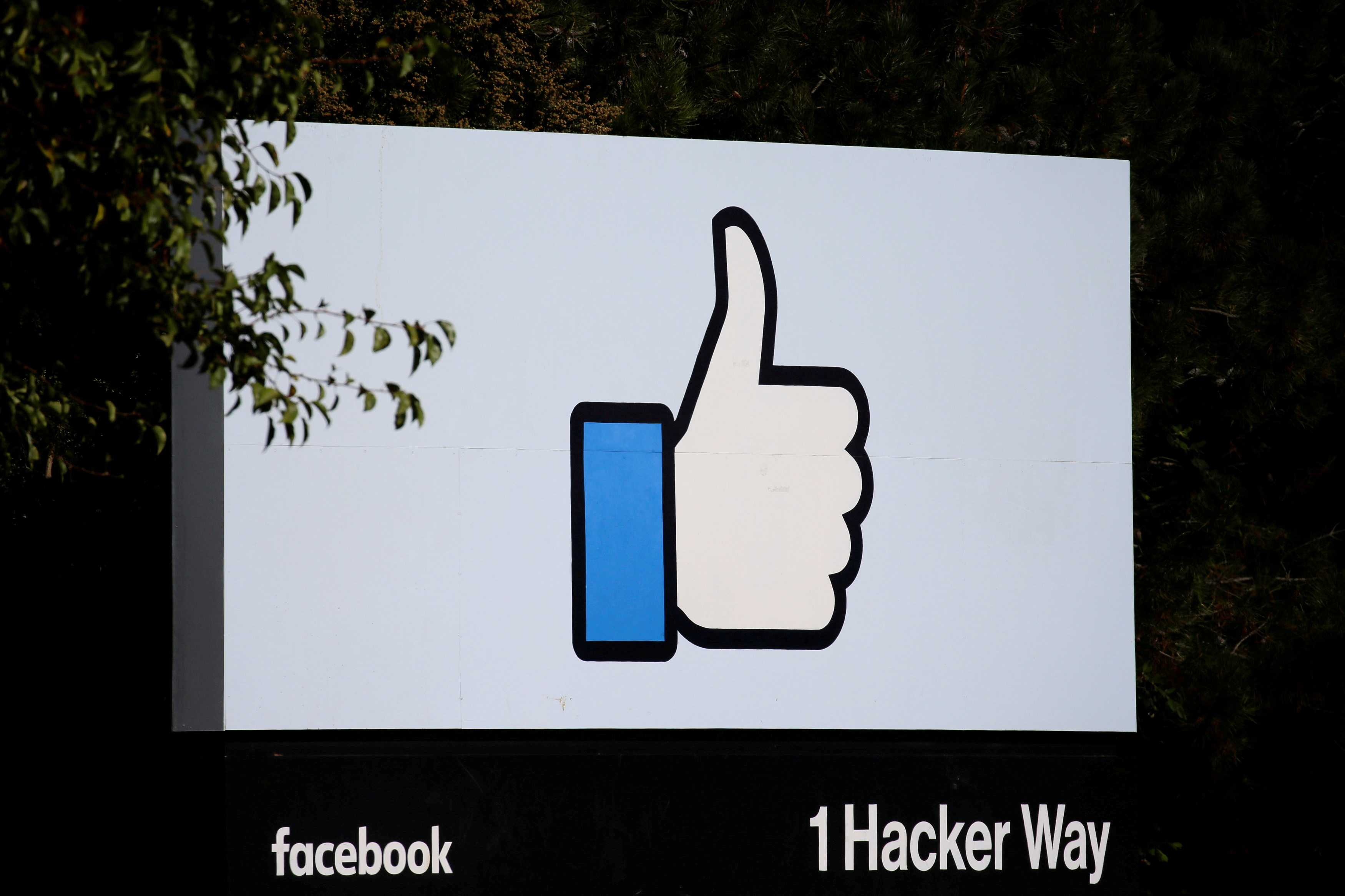 FILE PHOTO: The entrance sign to Facebook headquarters is seen in Menlo Park, California, on Wednesday, October 10, 2018. REUTERS/Elijah Nouvelage/File Photo