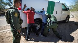 FILE PHOTO: Border Patrol agents arrest migrants who crossed the U.S.-Mexico border in the desert near Ajo, Arizona, U.S., September 11, 2018. REUTERS/Lucy Nicholson