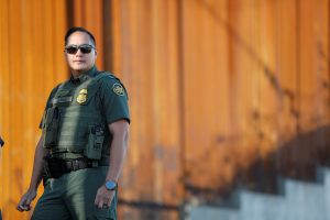 Agent J. Cruz of the U.S. Border Patrol looks on along the newly completed wall during U.S. Department of Homeland Security Secretary Kirstjen Nielsen's visit to U.S. President Donald Trump's border wall in the El Centro Sector in Calexico, California, U.S. October 26, 2018. REUTERS/Earnie Grafton