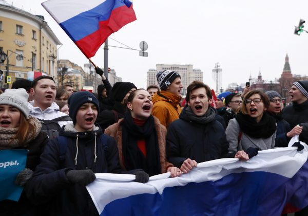 FILE PHOTO: Supporters of Russian opposition leader Alexei Navalny shout slogans during a rally for a boycott of a March 18 presidential election in Moscow, Russia January 28, 2018. REUTERS/Maxim Shemetov/File Photo