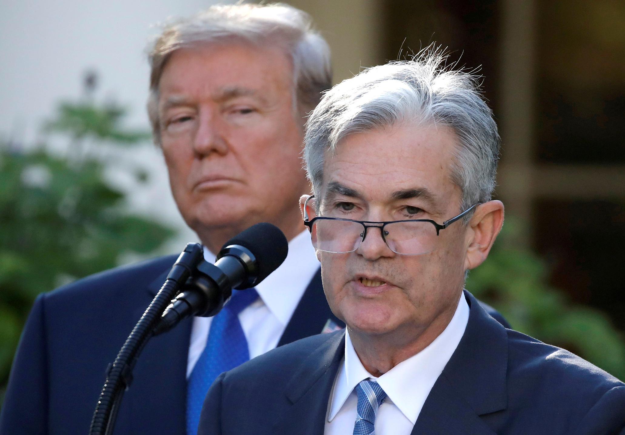 FILE PHOTO: U.S. President Donald Trump looks on as Jerome Powell, his nominee to become chairman of the U.S. Federal Reserve, speaks at the White House in Washington, U.S., November 2, 2017. REUTERS/Carlos Barria/File Photo