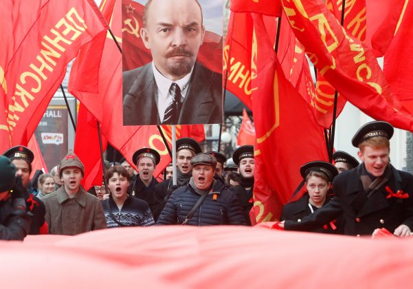 FILE PHOTO: Demonstrators carry flags and a portrait of Soviet state founder Vladimir Lenin during a rally held by Russian Communist party to mark the Red October revolution's centenary in central Moscow, Russia November 7, 2017. REUTERS/Sergei Karpukhin/File Photo