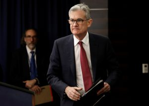 Federal Reserve Board Chairman Jerome Powell arrives at his news conference after a Federal Open Market Committee meeting in Washington, U.S., December 19, 2018. REUTERS/Yuri Gripas