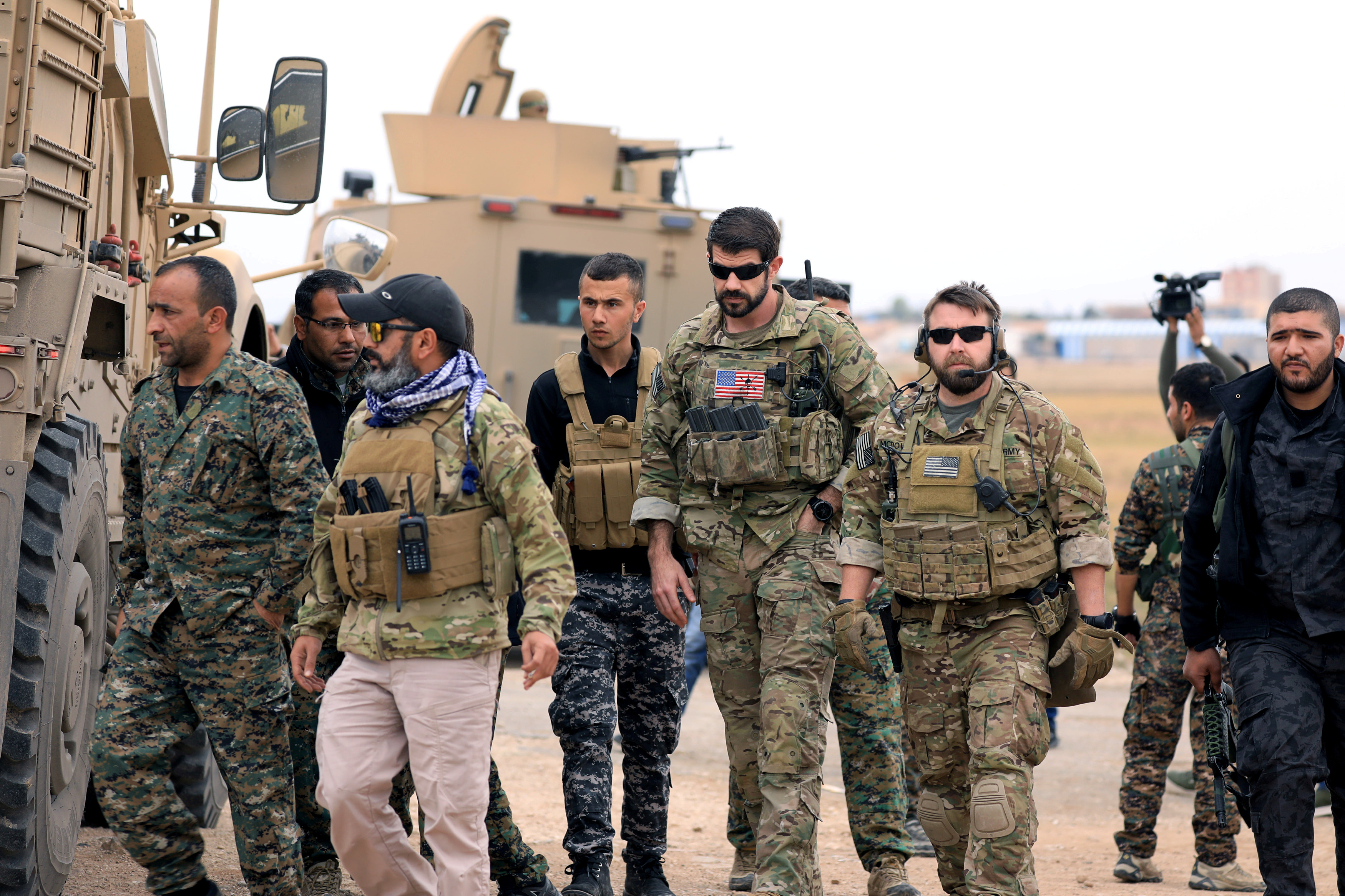 FILE PHOTO: Syrian Democratic Forces and U.S. troops are seen during a patrol near Turkish border in Hasakah, Syria November 4, 2018. REUTERS/Rodi Said/File Photo