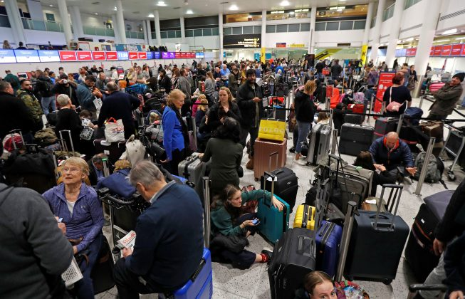 Passengers wait around in the South Terminal building at Gatwick Airport after drones flying illegally over the airfield forced the closure of the airport, in Gatwick, Britain, December 20, 2018. REUTERS/Peter Nichol