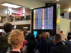 Stranded passengers look at the departures board at Gatwick Airport, Britain, December 20, 2018 in this picture obtained from social media. Ani Kochiashvili/via REUTERS