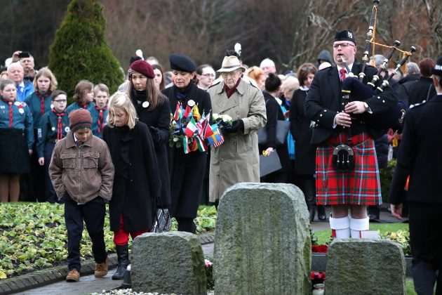 People gather for the service and wreath-laying at the Memorial Garden in Dryfesdale Cemetery, on the morning of the 30th anniversary of the bombing of Pan Am flight 103 which exploded over the Scottish town on December 21, 1988, killing 259 passengers and crew and 11 residents on the ground, in Lockerbie, Scotland, Britain, December 21, 2018. Jane Barlow/Pool via REUTERS
