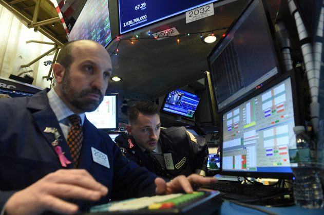 Traders work on the floor of the New York Stock Exchange (NYSE) in New York, U.S., December 21, 2018. REUTERS/Bryan R Smith