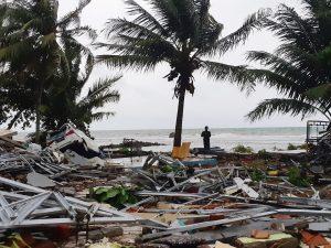 A man stands among ruins after a tsunami hit at Carita beach in Pandeglang, Banten province, Indonesia, December 23, 2018. REUTERS/Adi Kurniawan