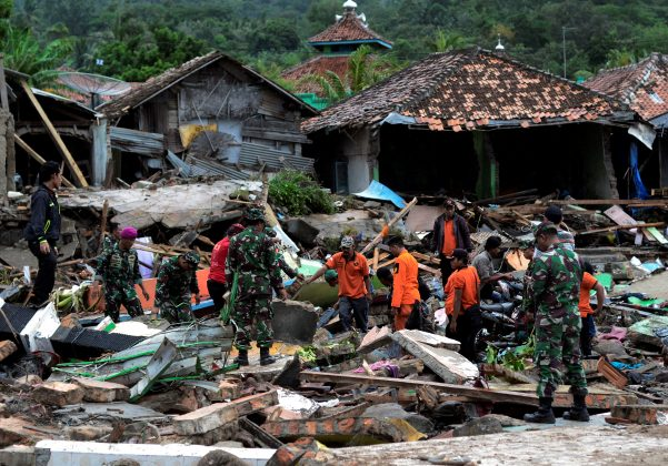 Rescue team members search for victims among debris after a tsunami hit at Rajabasa district in South Lampung, Indonesia, December 23, 2018 in this photo taken by Antara Foto. Antara Foto/Ardiansyah/ via REUTERS