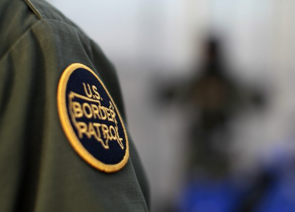 FILE PHOTO: A logo patch is shown on the uniform of a U.S. Border Patrol agent near the international border between Mexico and the United States south of San Diego, California March 26, 2013. REUTERS/Mike Blake
