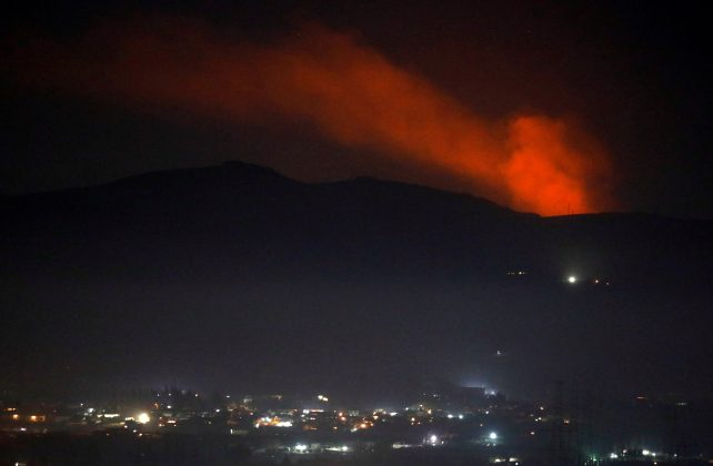 Smoke rises past a mountain as seen from Damascus countryside, Syria December 25, 2018. REUTERS/Omar Sanadiki