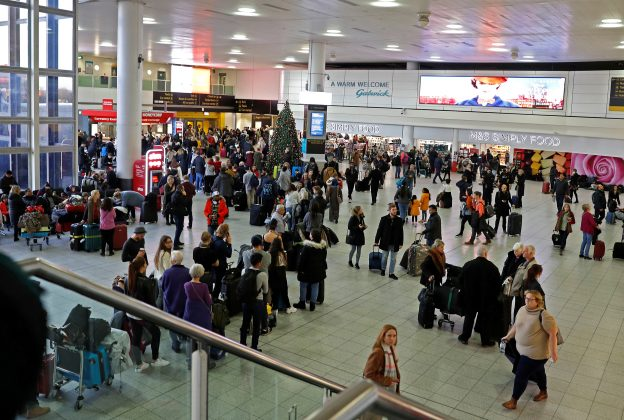 FILE PHOTO: Passengers wait around in the South Terminal building at Gatwick Airport after drones flying illegally over the airfield forced the closure of the airport, in Gatwick, Britain, December 20, 2018. REUTERS/Peter Nicholls