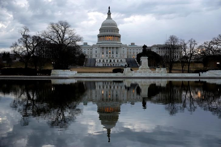 FILE PHOTO: Clouds pass over the U.S. Capitol at the start of the third day of a shut down of the federal government in Washington, U.S., January 22, 2018. REUTERS/Joshua Roberts