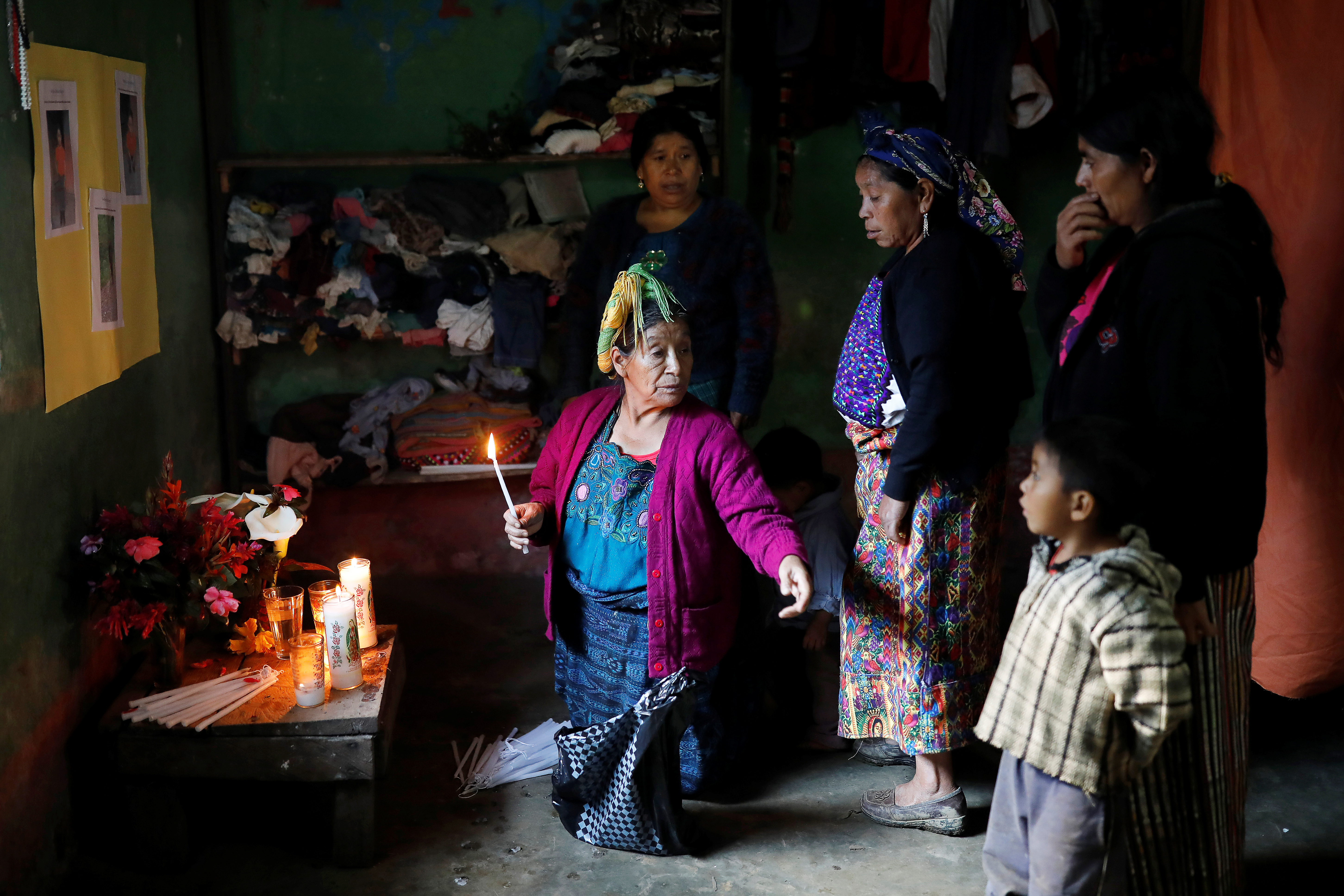Catarina Perez (C), grandmother of Felipe Gomez Alonzo, a 8-year-old boy detained alongside his father for illegally entering the U.S., who fell ill and died in the custody of U.S. Customs and Border Protection (CBP), gestures at an altar in memory of Felipe at the family's home in the village of Yalambojoch, Guatemala December 27, 2018. REUTERS/Luis Echeverria