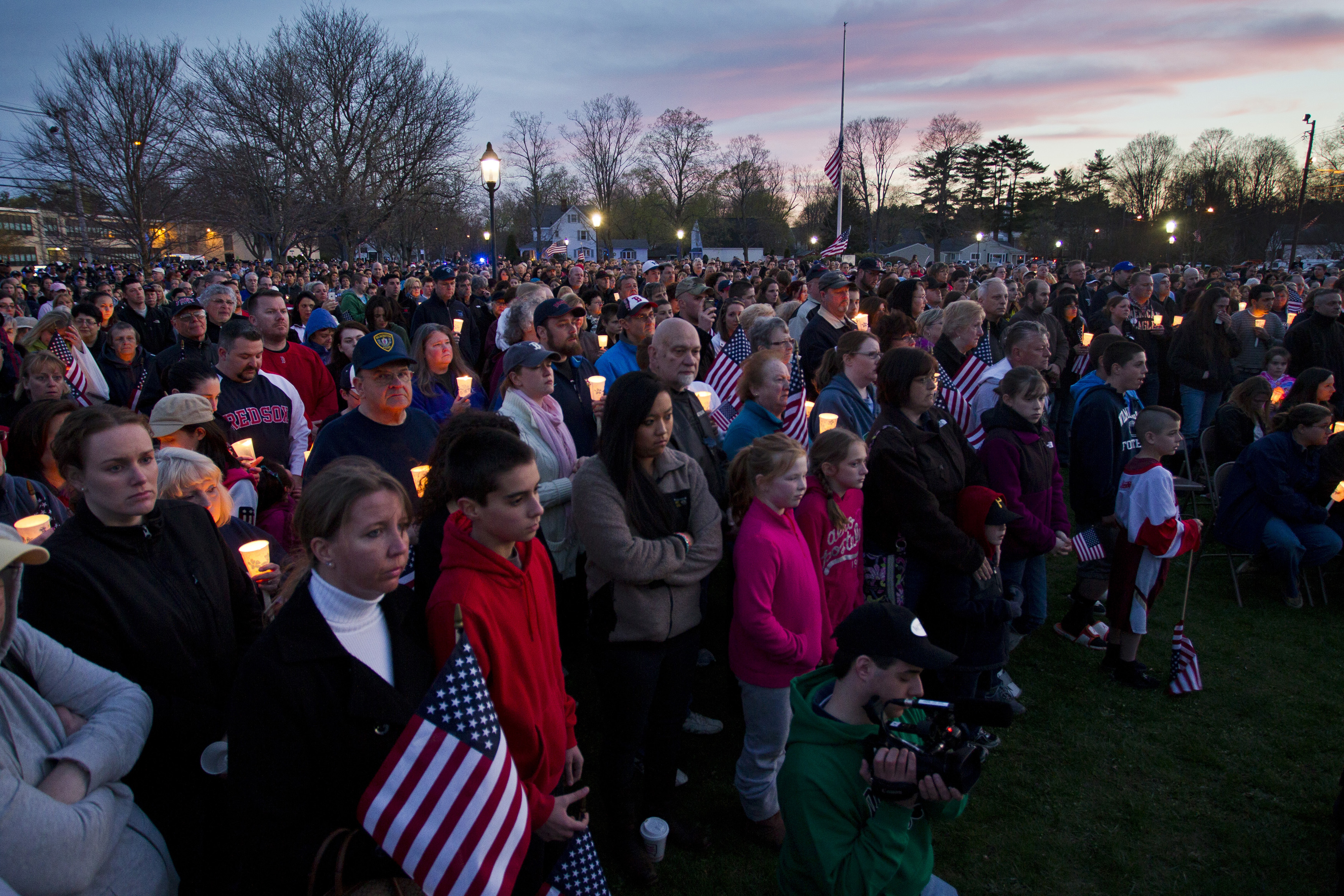 FILE PHOTO: People hold candles during a vigil at the Town Common in Wilmington, Massachusetts, April 20, 2013. REUTERS/Dominick Reuter