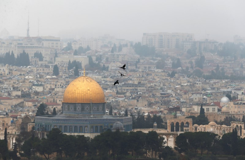 Birds fly on a foggy day near the Dome of the Rock, located in Jerusalem's Old City on the compound known to Muslims as Noble Sanctuary and to Jews as Temple Mount, Jerusalem, January 2, 2018. REUTERS/Ammar Awad
