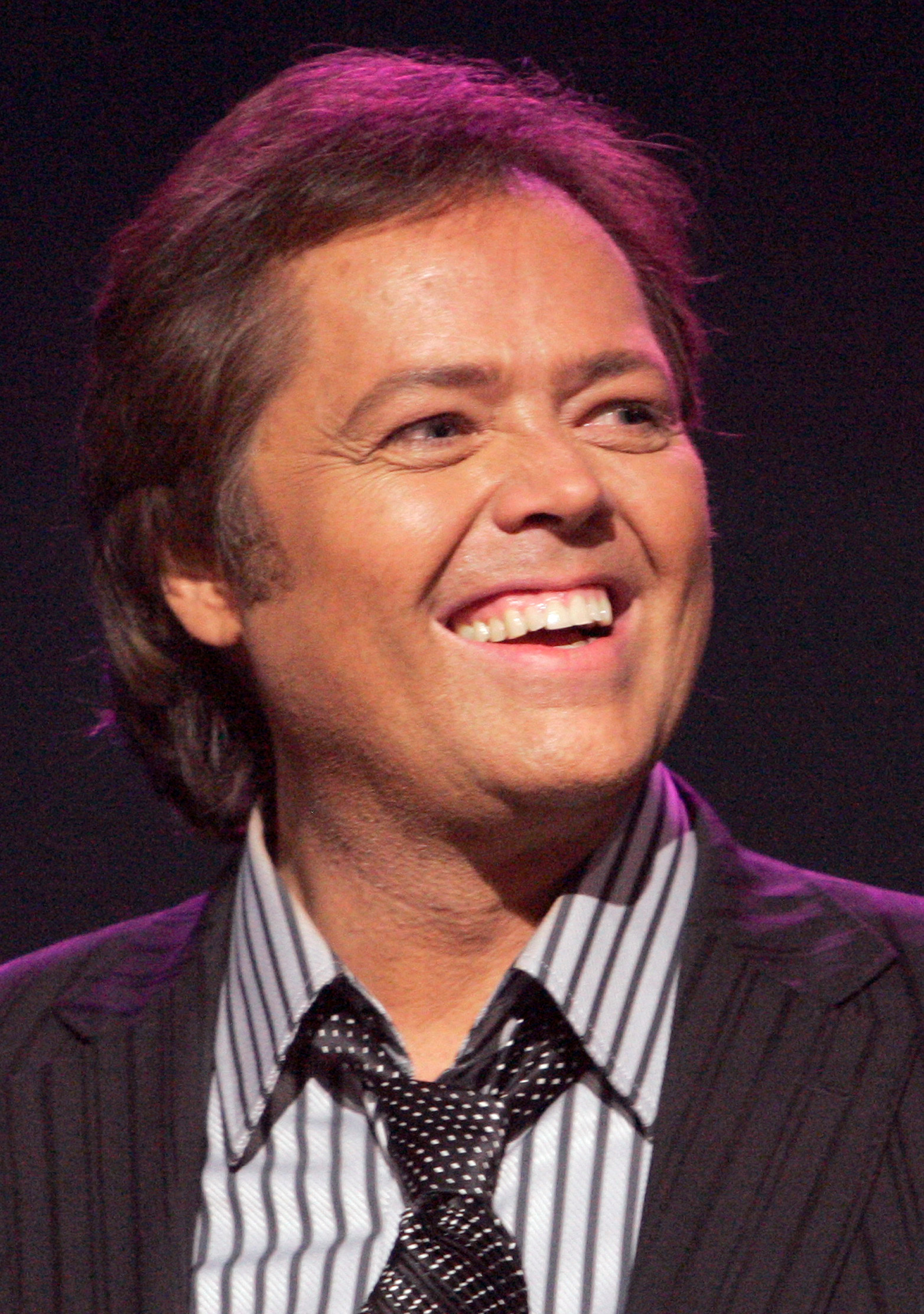 FILE PHOTO: Jimmy Osmond smiles at an Osmond 50th anniversary show at the Orleans hotel-casino in Las Vegas, Nevada August 13, 2007. REUTERS/Steve Marcus