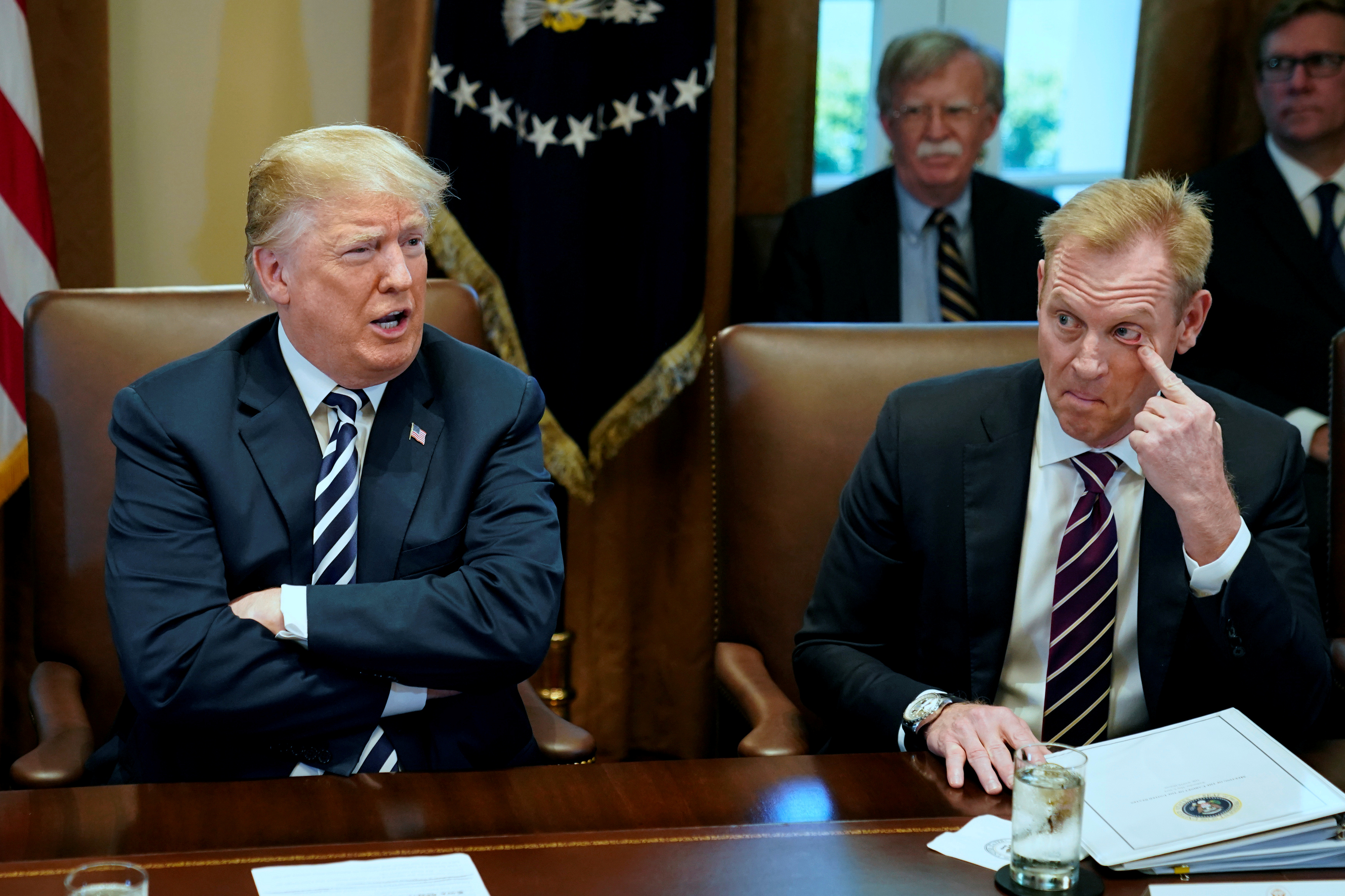 FILE PHOTO: U.S. President Donald Trump, flanked by Deputy Secretary of Defense Patrick Shanahan, holds a cabinet meeting at the White House in Washington, U.S. May 9, 2018. REUTERS/Jonathan Ernst/File Photo
