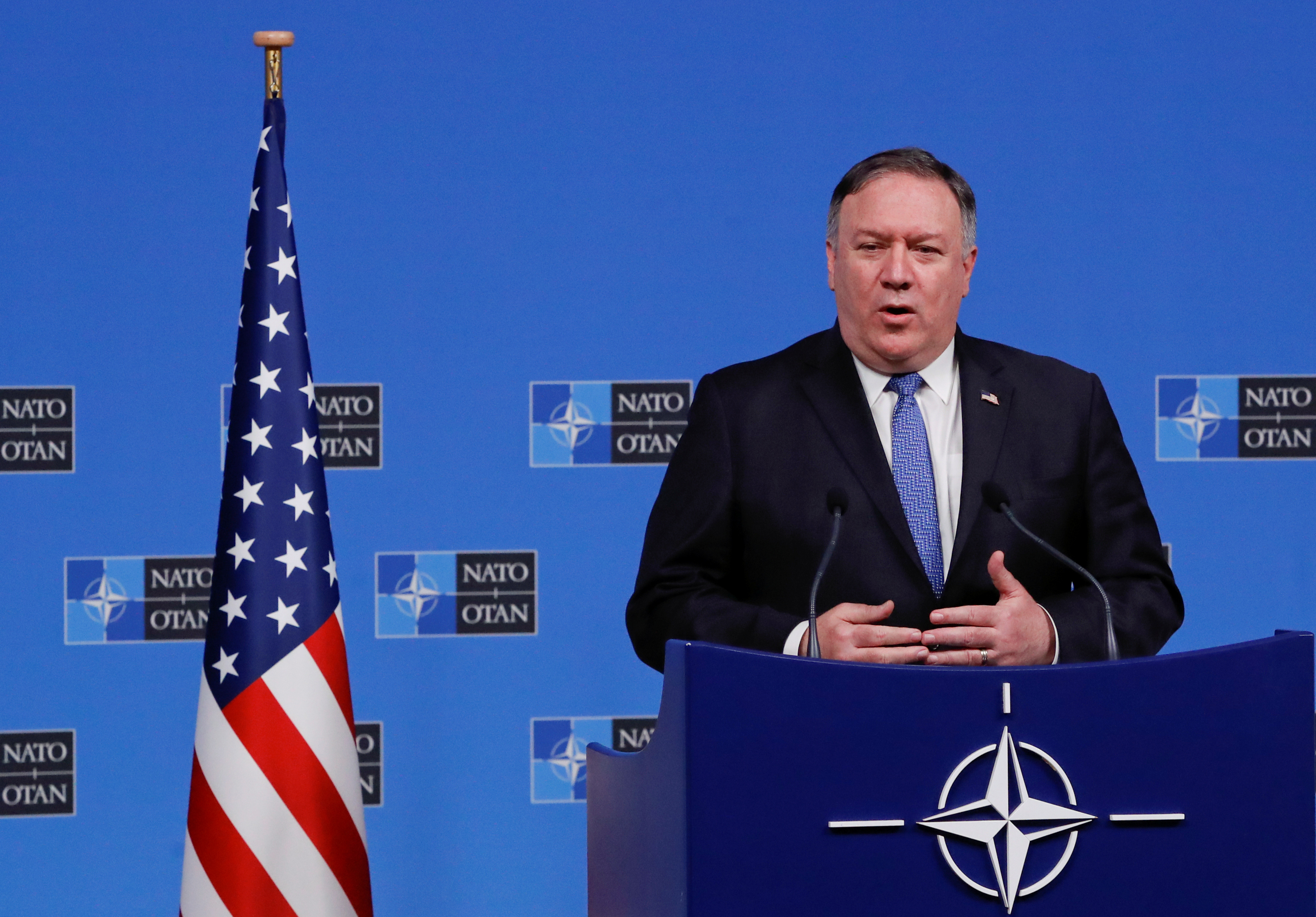 FILE PHOTO: U.S. Secretary of State Mike Pompeo speaks at a news conference during the NATO foreign ministers' meeting at the Alliance's headquarters in Brussels, Belgium, December 4, 2018. REUTERS/Yves Herman