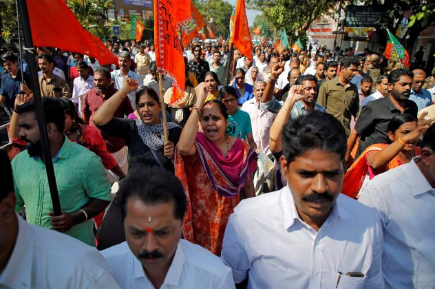 Supporters of India's ruling Bharatiya Janata Party (BJP) and Hindu nationalist organisation Rashtriya Swayamsevak Sangh (RSS) attend a protest rally during a strike against the state government for allowing two women to defy an ancient ban and enter the Sabarimala temple, in Kochi, India, January 3, 2019. REUTERS/Sivaram V