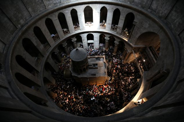 Christian worshippers from the Orthodox denominations celebrate the Holy Fire ceremony at the Church of the Holy Sepulchre in Jerusalem's Old City, April 7, 2018. REUTERS/Ammar Awad