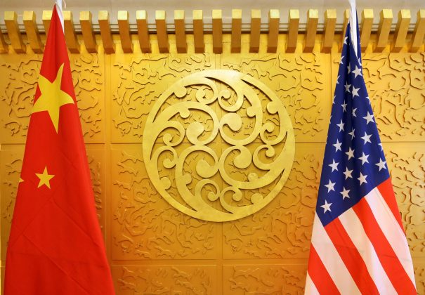 FILE PHOTO: Chinese and U.S. flags are set up for a meeting during a visit by U.S. Secretary of Transportation Elaine Chao at China's Ministry of Transport in Beijing, China April 27, 2018. Picture taken April 27, 2018. REUTERS/Jason Lee/File Photo