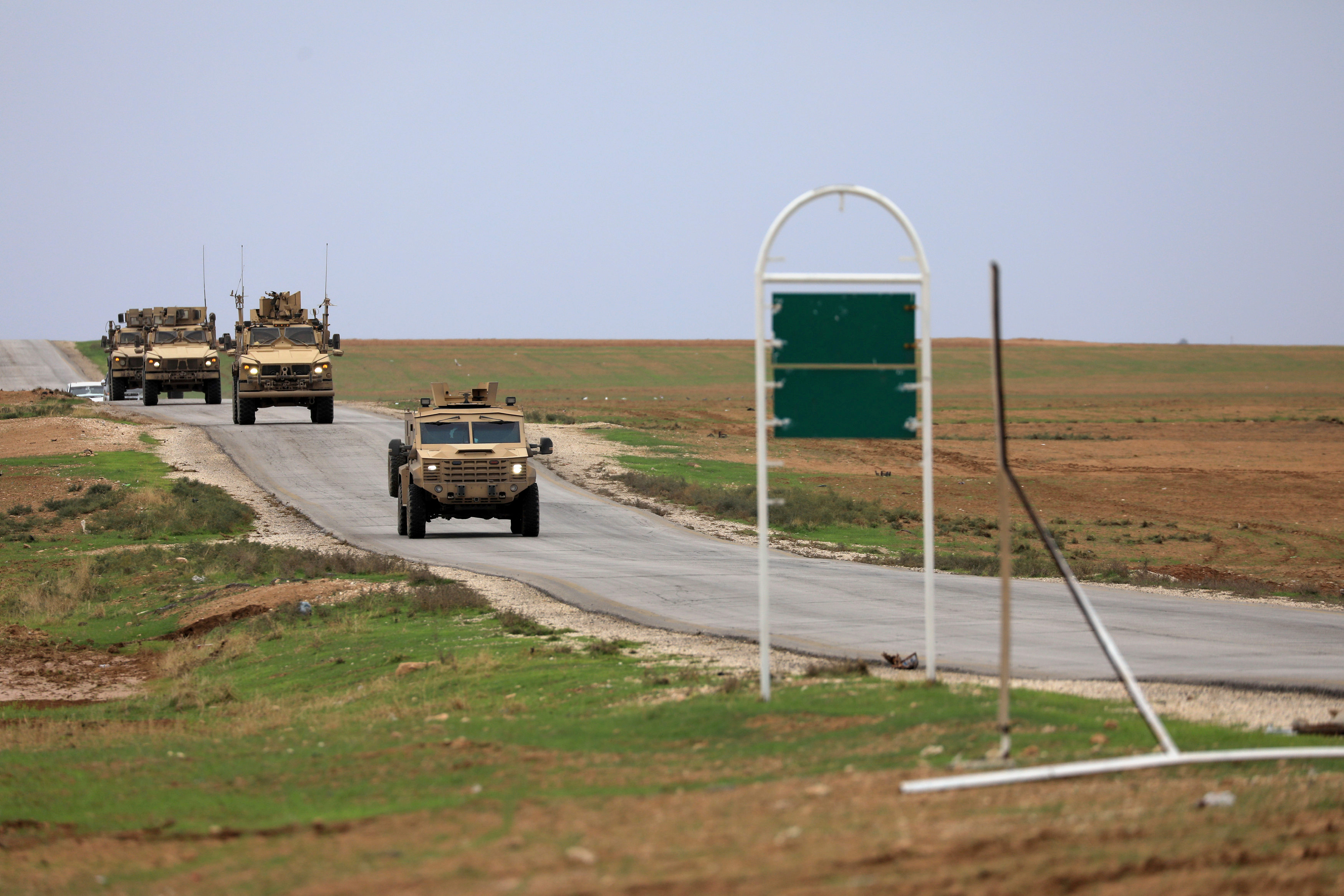 FILE PHOTO: U.S. troops patrol near Turkish border in Hasakah, Syria, November 4, 2018. REUTERS/Rodi Said/File Photo