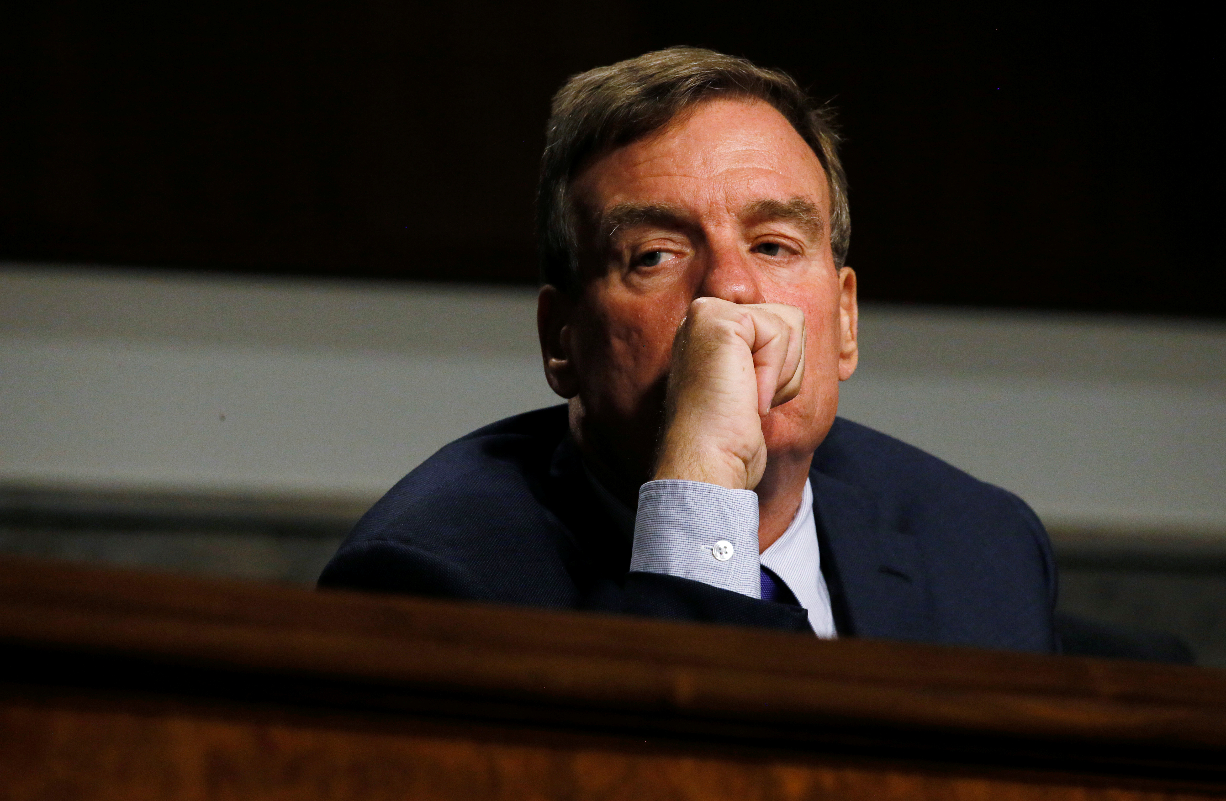 FILE PHOTO: Senate Intelligence Committee Vice Chairman Senator Mark Warner listens to testimony from Twitter CEO Jack Dorsey and Facebook COO Sheryl Sandberg at a hearing on foreign influence operations on social media platforms on Capitol Hill in Washington, U.S., September 5, 2018. REUTERS/Jim Bourg